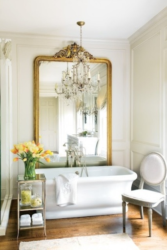 white bathroom with gold mirror_pinterest
